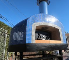 The custom blue tile shines brightly in the California sun on this Pizza Oven from Forno Bravo! Wood Fired Oven, Wood Fired Pizza, Commercial Pizza Oven, Mobile Pizza Oven, Four A Pizza, Pizza Ovens, Blue Tiles, Firewood, Around The Worlds