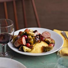 Brussels Sprouts with Sausage and Grapes on Creamy Polenta