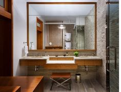 12. Choose a larger mirror to reflect more space.