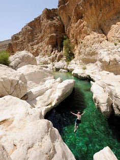 A swimmer explores a spring-fed pool at the popular Wadi Bani Khalid, near the town of Ibra, Oman