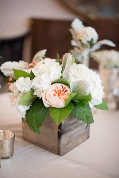 peach and white flowers 600x600_1415313768233-tory-joshua-s-wedding-signature-images-0090