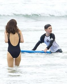 Crown Princess Mary and older son Prince Christian didn't appear to feel the cooler water temperatures when they took a dip in the morning (pictured) at Sydney's Palm Beach.