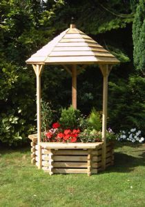 Wishing Well planter... Pretty much the most adorable thing. My dream.
