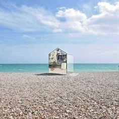 The beach huts traditionally found in English seaside towns informed this temporary mirror-clad cabin installed by ECE Architecture on the coast in Sussex