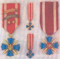 Хрест Українського Козацтва (з мечами) - затверджений 20.10.1947 року Президентом УНР в Екзилі Андрієм Лівицьким