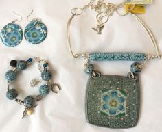Blue and white floral set of necklace, bracelet and earrings.