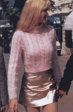claudia schiffer acrylic sparkles thick woven cotton candy turtle neck with, obviously, gold lame' looking leather mini skrt and fluffed-out blond bangs hair
