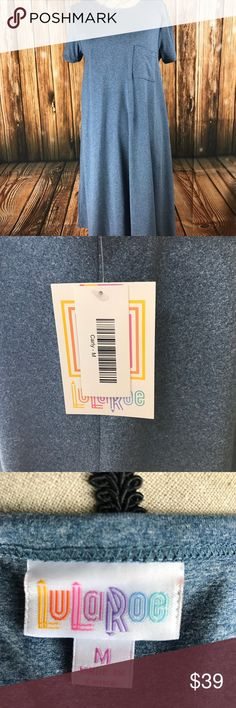 LuLaroe Heather Blue Carly 🌈New with tags! This is a HTF color, especially in this size. Only one small flaw (tiny hole) as shown in last photo, not noticeable. Make an offer or bundle with your likes for an even better deal. 🤓 LuLaRoe Dresses