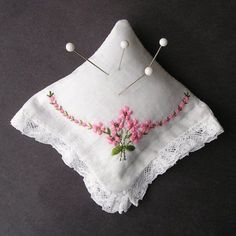 Love this: a vintage handkerchief for a pincushion. Great way to use all those hankies I've inherited. So pretty!