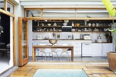 Bifold doors bringing the outside in - the deck becomes part of the kitchen/living space: Mark Williams' photography, designer unknown.