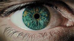 close up of eye pupils dilating gif