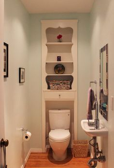 1/2 bath with shelving built into the wall. Not crazy about the decorative cutouts, but I like the concept of effectively utilizing wall space for storage in such a small room.