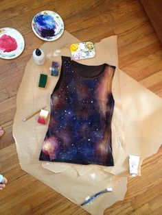 DIY galaxy shirt- splash/spray with bleach, tie-dye red, bleach again, paint/sponge on red/blue dye/paint and finish with white fabric paint stars flicked on..... If only it would actually look like that when I finish