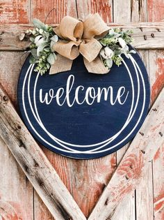 Round Door Hanger - Farmhouse wall decor Welcome Sign, Welcome sign for the front door! This round navy welcome door hanger is so fresh and so farmhouse. Our wooden welcome sign is adorned with cotton & gr. Welcome Signs Front Door, Wooden Welcome Signs, Rustic Wood Signs, Front Door Decor, Wooden Door Signs, Rustic Doors, Wooden Doors, Round Door, Farmhouse Wall Decor