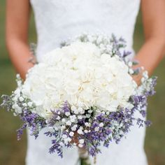 lavender, baby's breath, and white or book page roses