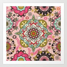 Small birds peek from colorful mandalas on a pale pink bagground with flowers and leaves.
