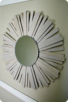 Sunburst Mirror with wood shims for over the bed in Master Bedroom