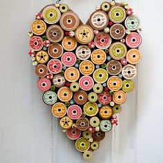 Fun folk art using a heart shaped plaque and spools of thread. Does this give you other ideas like US Flags or Christmas trees?