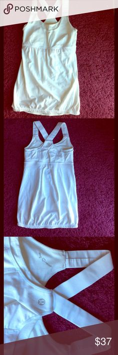 Lululemon 2 white razorback yoga tank top floral Unique lululemon white floral mesh razorback yoga tank top. No slip grip at the bottom on the hem and a built in bra. No defects stains tears holes etc. Very nice very clean! lululemon athletica Tops Tank Tops