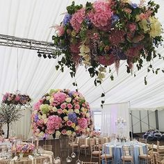Brightening the room with lush pastel floral is event florist #redfloral. Beautiful work! #redfloral #marqueewedding #sequintealightholders #sequinlinen #weddingflowers #weddingflowers #floralchandelier #centeriece #thorntonmanor #redfloralarchitecture #w
