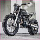 """bike-exif: """"looks like a bundle of fun, doesn't it? According to builders Kyle Scott and Chris Clokie, """"The idea was to produce a stripped down, street-legal custom bike inspired by the flat track racing scene."""" The rider is a lady new to the. Honda Dominator, Yamaha Tw200, Motos Yamaha, Moto Scrambler, Moto Bike, Scrambler Custom, Street Scrambler, Tracker Motorcycle, Motorcycle Quotes"""