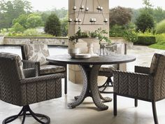 Tommy Bahama Blue Olive Round Dining Table and Outdoor Swivel Chairs | Lexington Home Brands Furniture