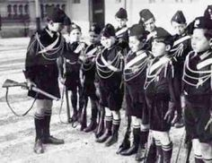 The young boys in the photo were members of the Italian Balilla and Vanguards, a para-military fascist youth organization founded shortly after Italian dictator Benito Mussolini came to power in 1922.