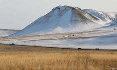 Trucks drive along the federal highway in the steppe area north of Abakan in the Republic of Khakassia, Russia, March (Photo by Ilya Naymushin/Reuters) Down From The Mountain, Eurasian Steppe, The Republic, Climbers, Mountains, World, Russia, March, Travel