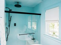 Privately connected to the master bedroom and with an attached closet, the master bath takes a bright turn with an allover brilliant blue palette, including wall color and matching penny tile.