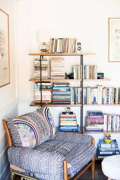 Love this as a reading nook idea in the corner of the living room by the brick wall. Fun chair. #ChairFabric