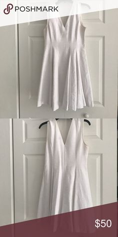 Semi-formal all white Cotton/Poly Blend dress Dress perfect for graduation, convocation, conformation or a summer's day! Beautifully woven, cotton/poly blend with a fitted waste and flattering skirt. Message me if you want to see more detailed pictures! This is honestly one of my favorite dresses it just doesn't fit me anymore. Chelsea 28 Dresses Midi