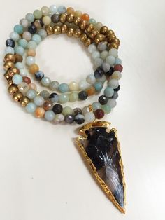Black Crystal Arrowhead on a Amazonite and Ethiopian Beaded Necklace