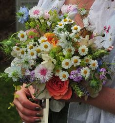 Wild style rustic wedding bouquet using British garden flowers like lavender, pink cornflowers, love-in-a-mist, daisies, garden roses, wheat and candy tuft. www.wildandwondrousflowers.co.uk