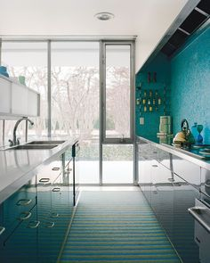 A mosaic tile wall softens the laboratory-like effect of the glossy kitchen cabinets in the famed Miller House. The home was only opened recently to the public; click through to see it in all its sumptuous midcentury glory.