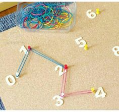 Fine motor skills with bands and push pins on a board pop or could use cardboard