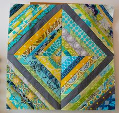 """11"""" finished block comprised of four smaller blocks.  Foundation pieced on muslin.  I like the use of the dark center."""