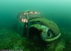 The shell of a VW beetle that was purposely sunk in Capernwray Quarry in Lancashire as an attraction to divers