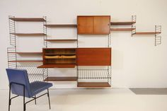 Gorgeous Teak and Brass Wall Unit with Desk and Bar Cabinet by Nisse Strinning | From a unique collection of antique and modern shelves at https://www.1stdibs.com/furniture/storage-case-pieces/shelves/