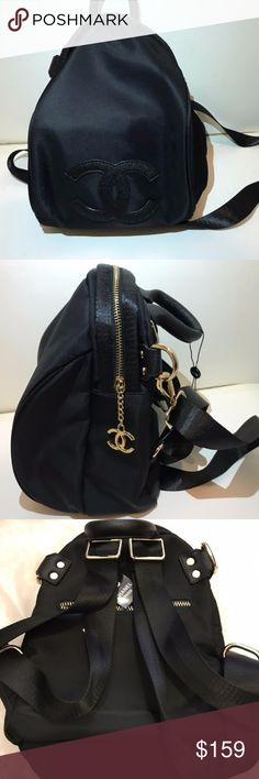 Chanel Backpack Cross body Bag VIP Gift Bag Authentic 2017 Chanel VIP gift backpack cross body bag Shoulder bag , Nylon ,Black ,Gold Hardware, New. You can use it as a backpack or a cross body bag or a shoulder bag. Size H 12 x 8 x D 6.This is a VIP gift form Chanel Korea . VIP gift does not come with any serial number/card, please make sure you like the size before you purchase it. Please read description, And Please feel free to ask any questions, thanks. CHANEL Bags Backpacks