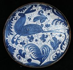 Spanish blue and white tazza, Teruel (1650-1700), decorated with a leaping hare on a ground of stylised flowers and insects with smaller scrolls and tendrils, diameter: 9 in. 23cm.