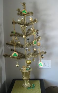 our Swirly St. Patrick's ornaments on a gold feather tree.  www.swirlydesigns.com