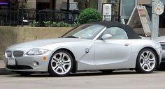 """BMW Z4 -- When debuted, it wonAutomobile Magazine""""Design of the Year Award"""". Starting with the 2009 model year, the second-generation Z4 is built at BMW'sRegensburg, Germanyplant as a retractable hardtop roadster. In 2009, the BMW Z4 won theRed Dot Design Award."""