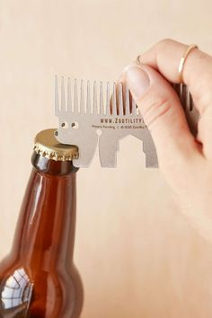 """A """"zootility"""" tool that features a bottle opener, comb, hex wrench, screwdriver, and more."""