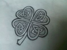 Close to the clover design I want at the center of the dragon. Still not sure how it'll be (in the scaling on the back on a medallion held by the dragon etc). Still mad I can't find the clover that started it all almost 10 years ago! Tattoos For Childrens Names, Tattoos With Kids Names, Celtic Clover Tattoos, Celtic Tattoos, Time Tattoos, New Tattoos, Cool Tattoos, Tatoos, Shamrock Tattoos