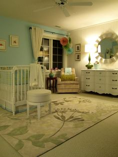Such a soft nursery!  I love the creams with the blues. Although it would be ideal to have a large room like this, I think this idea would make a smaller room look even larger.  Notice the two colored walls, the formal mirror (unexpected but wonderful for Mom as well as room-expanding), the fabulous rug.  I cannot say enough about this room.