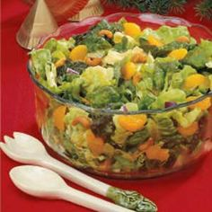 Mandarin-Cashew Tossed Salad Recipe -Mandarin oranges and chopped red onion add a touch of color to mixed greens and sweet roasted cashews in this refreshing salad.