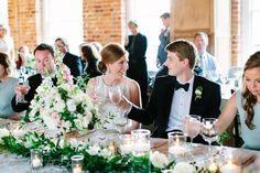 Head table flowers of white, pink and peach. Candles, garland and fresh spring flowers by Artfully Arranged Anna Routh Photography