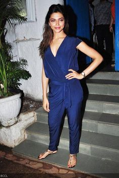 Leggy actress Deepika Padukone's tall figure is perfect for this simple yet stylish silk blue jumpsuit. #Bollywood #Fashion #Style #Beauty
