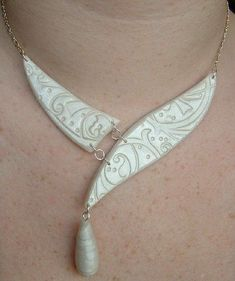 A lovely necklace. I've made the components, but can't find my tools to assemble.:
