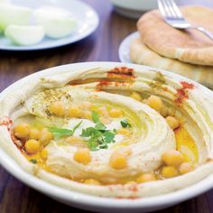 "Before opening Zahav restaurant in Philadelphia, chef Michael Solomonov visited hummus parlors all over Israel trying to find the best recipe. ""Hu..."